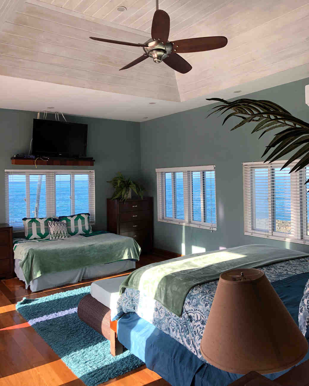 air bnb wedding venue green bedroom overlooking the ocean