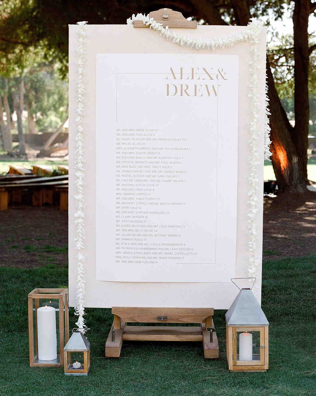 alex drew california wedding seating chart sign with lanterns