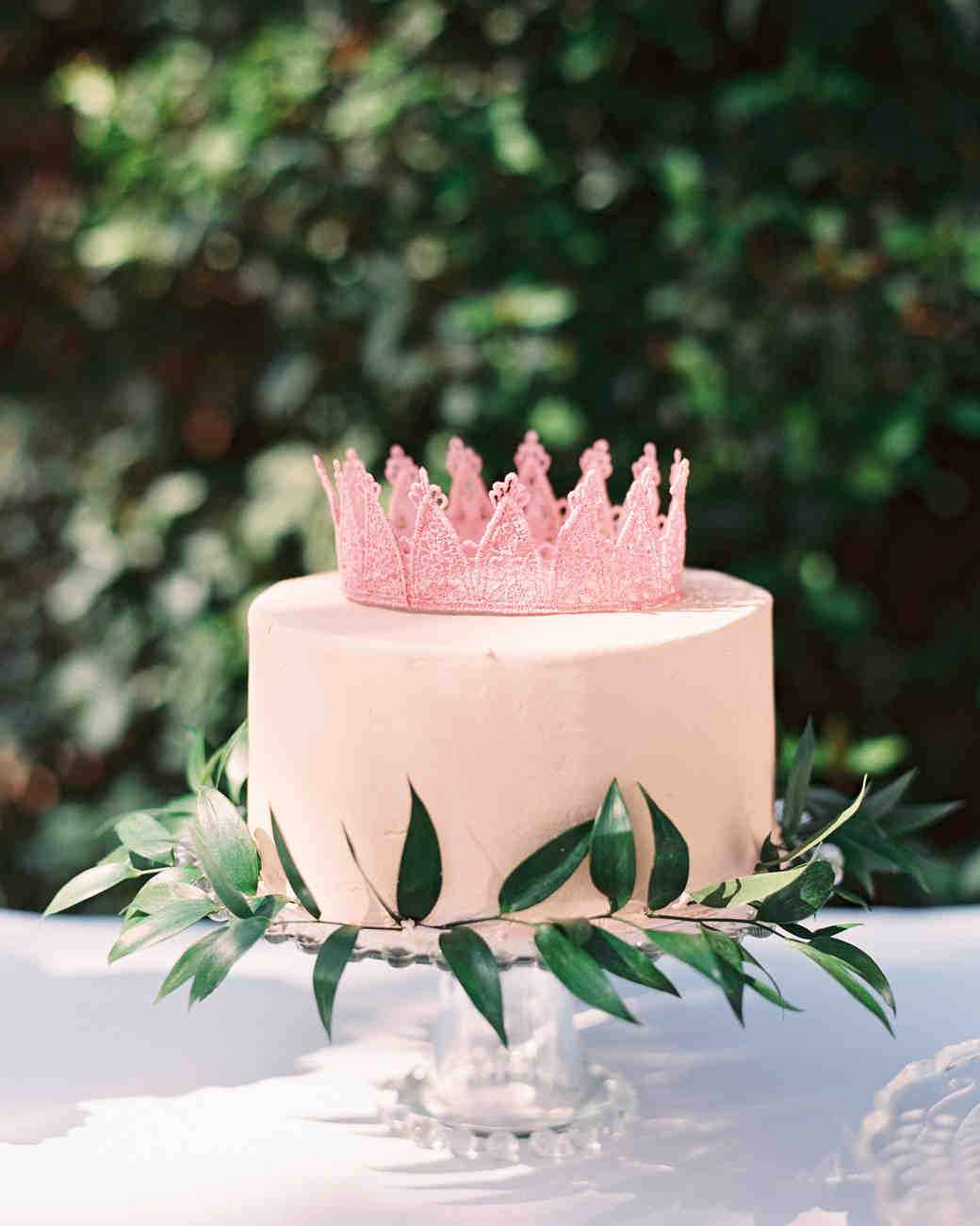 pink cake with crown topper