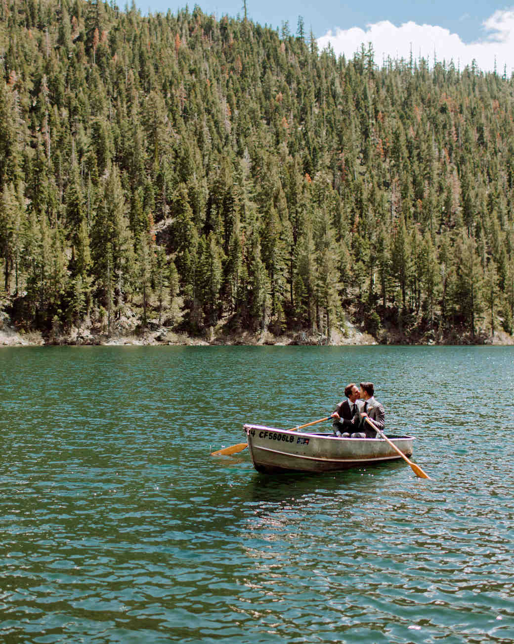 Court & Kelsey kissing in canoe on lake
