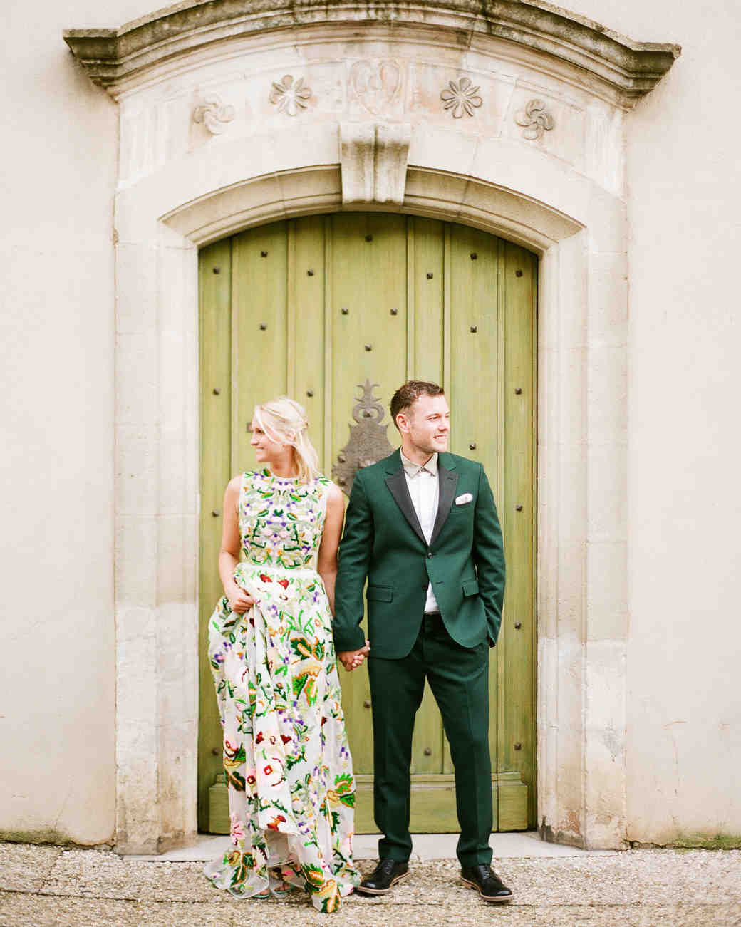 engagement party couple green doorway outdoors