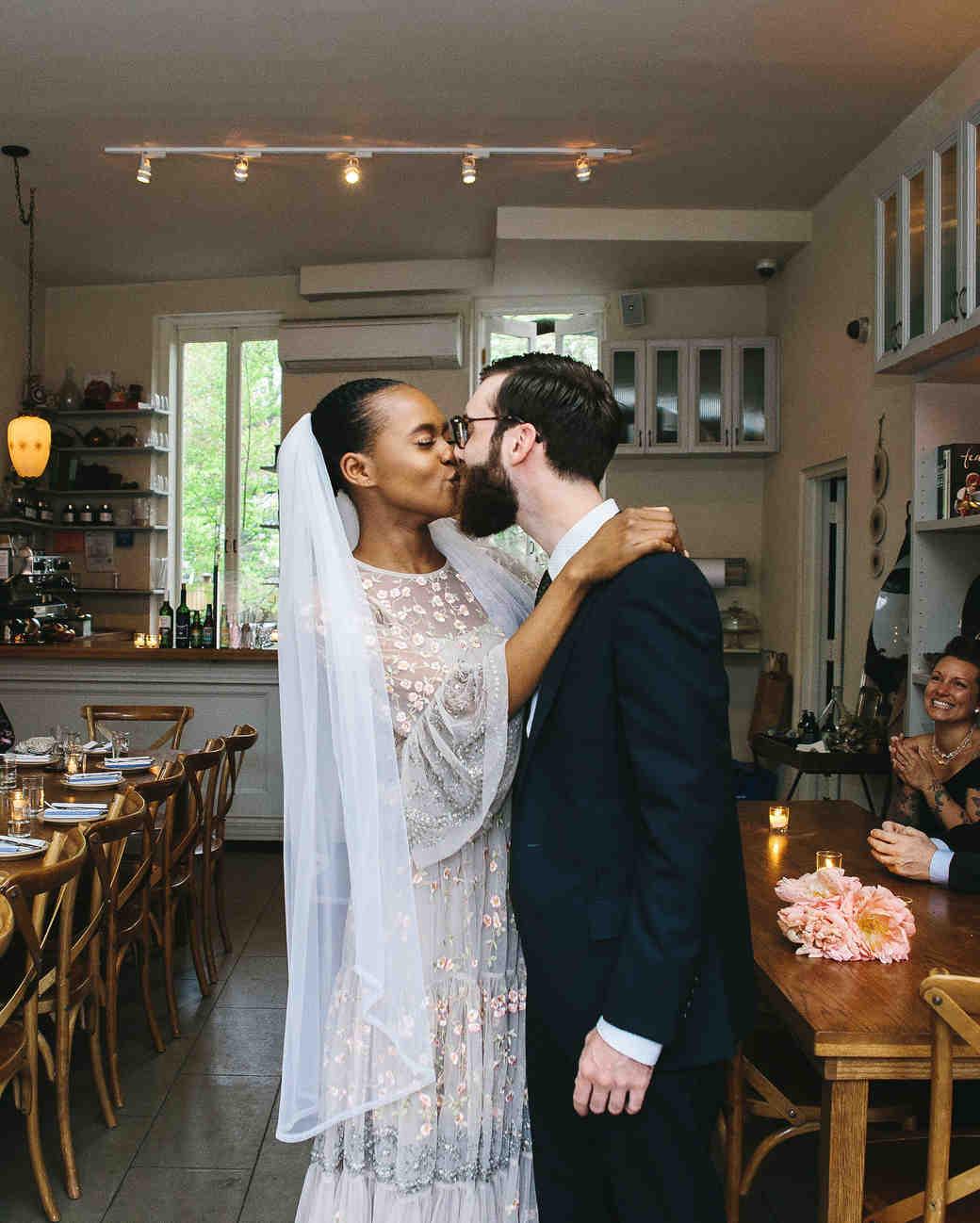 lola quinlan elopement ceremony kiss bride and groom