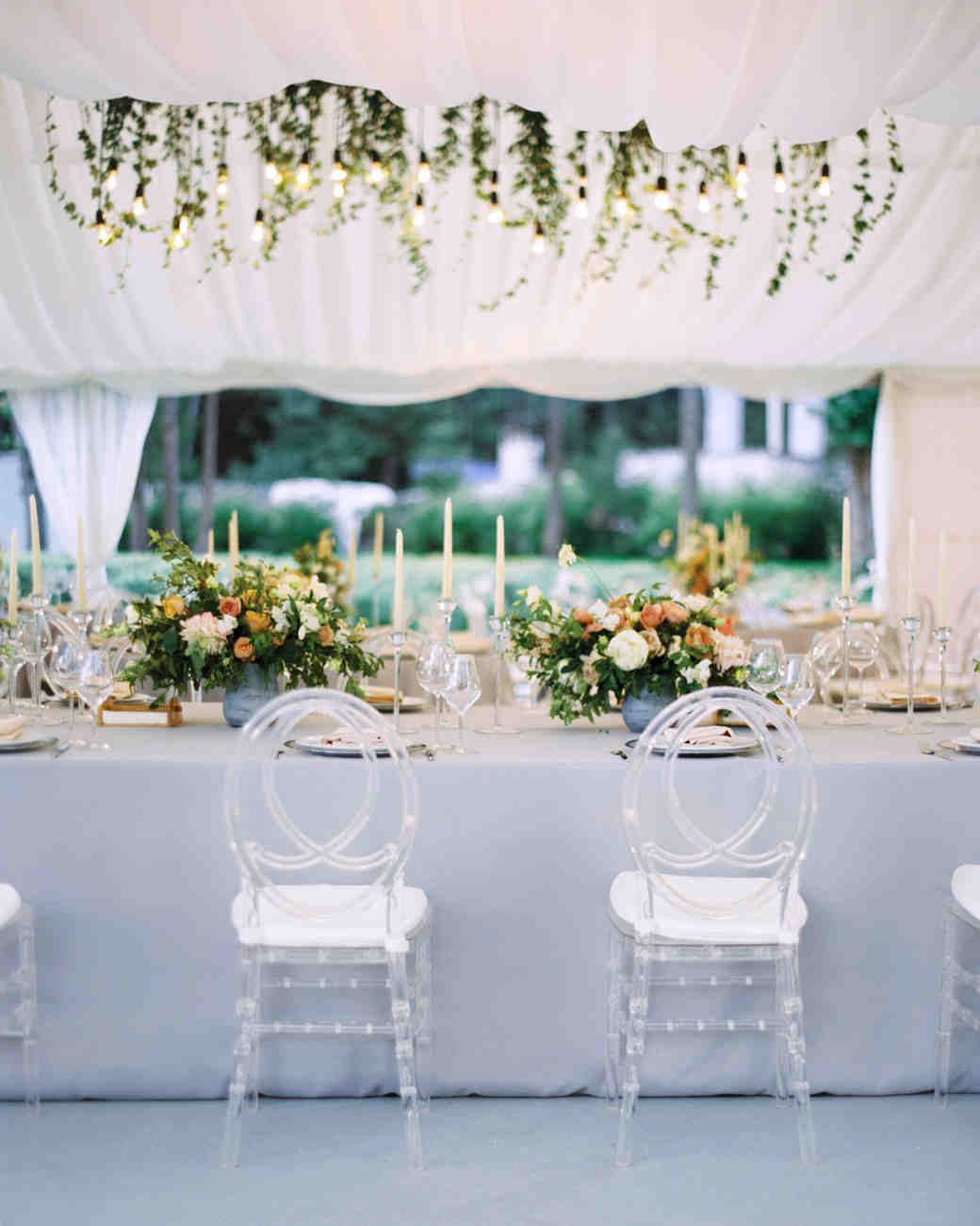 lucite chairs with an infinity back set up at reception table