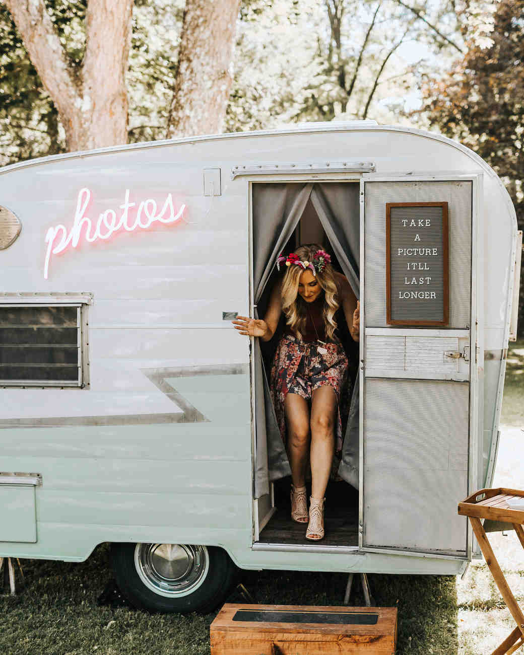 photos neon sign on photo booth camper