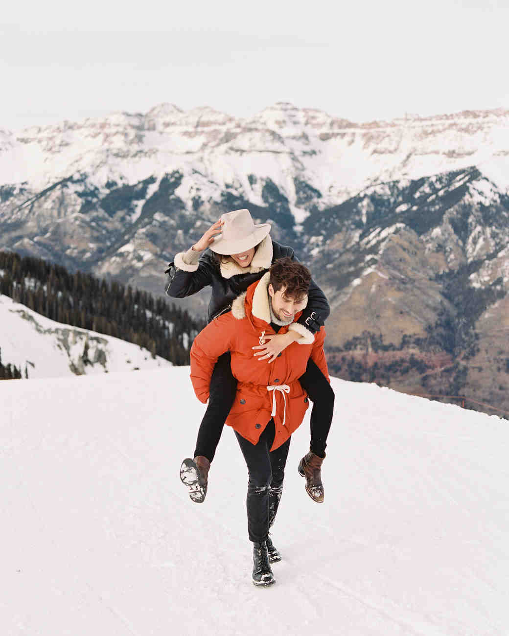couple on snow mountains outdoor engagement photo