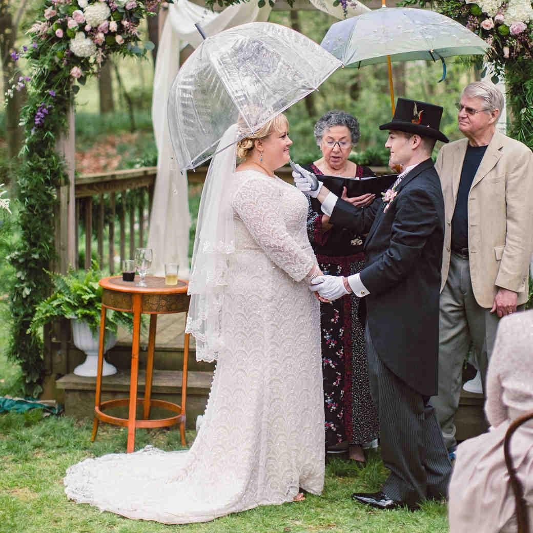 rainy wedding couple outside ceremony