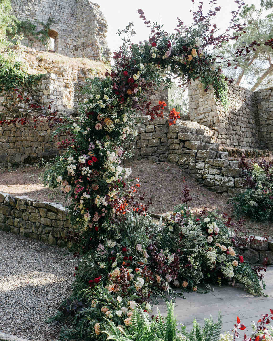 sara sam italy wedding ceremony arch