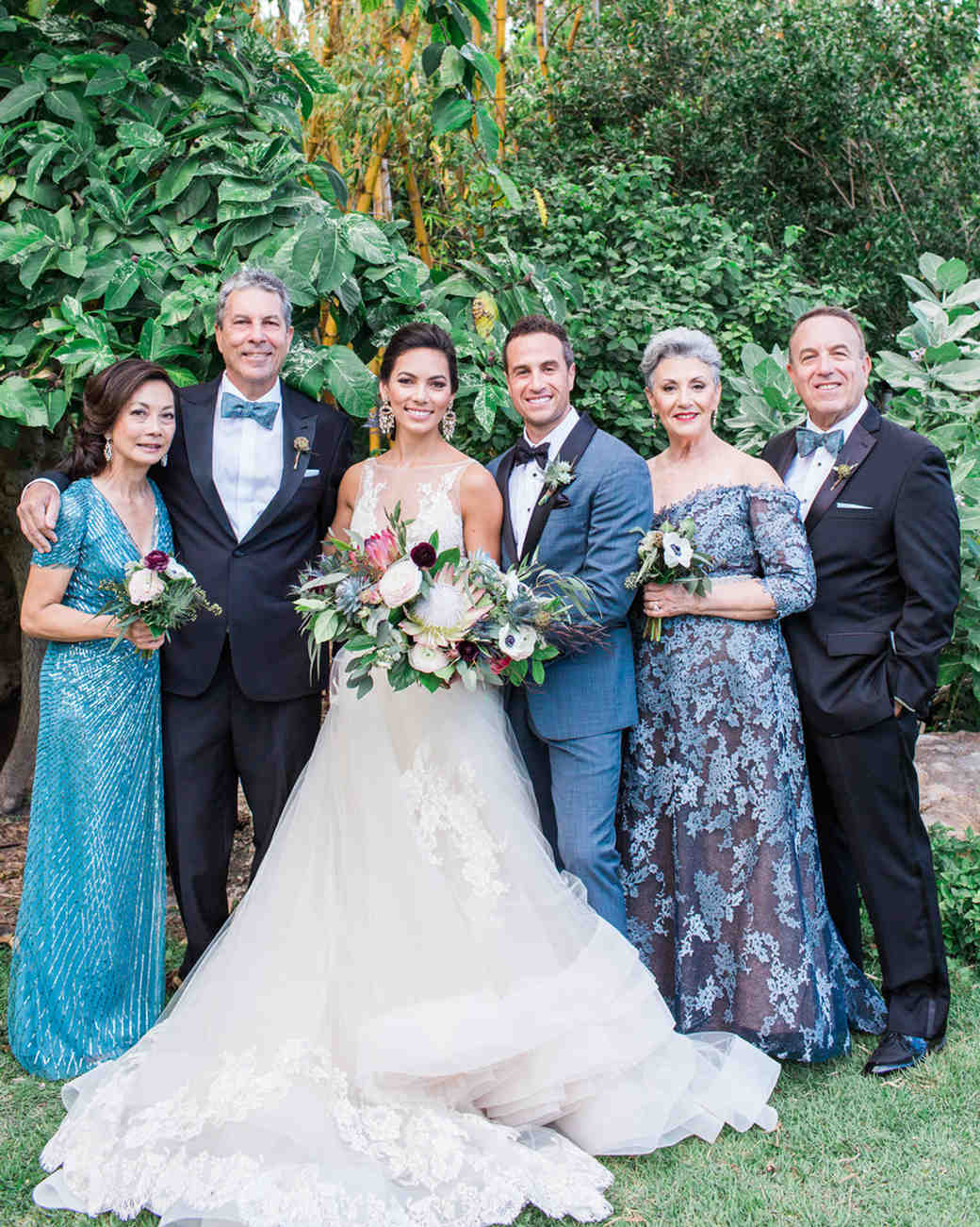bride and groom with both sets of parents