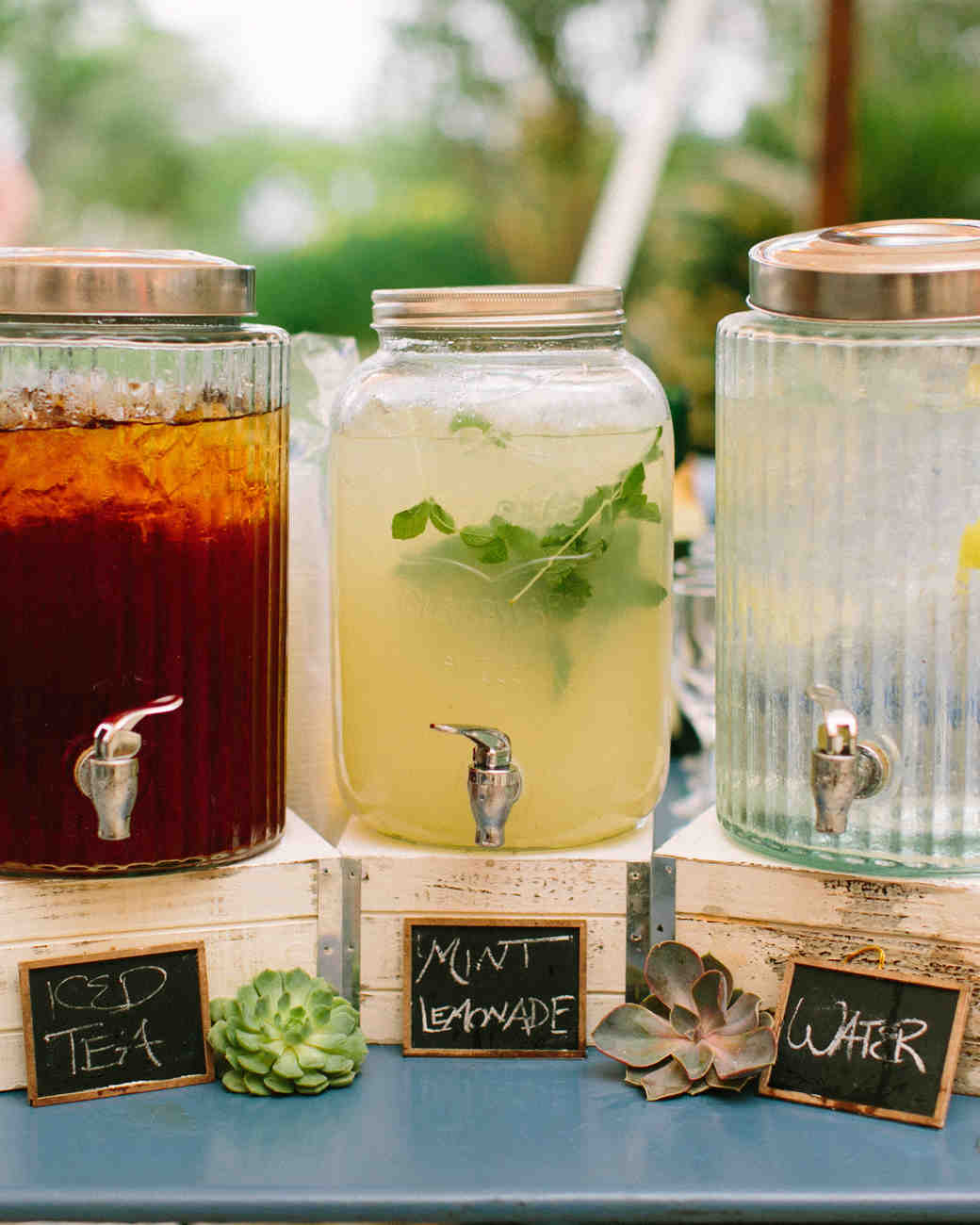 Water, lemonade and iced tea station at an outdoor wedding