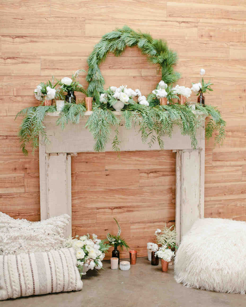 winter rehearsal dinner fire place with greenery mantel decor