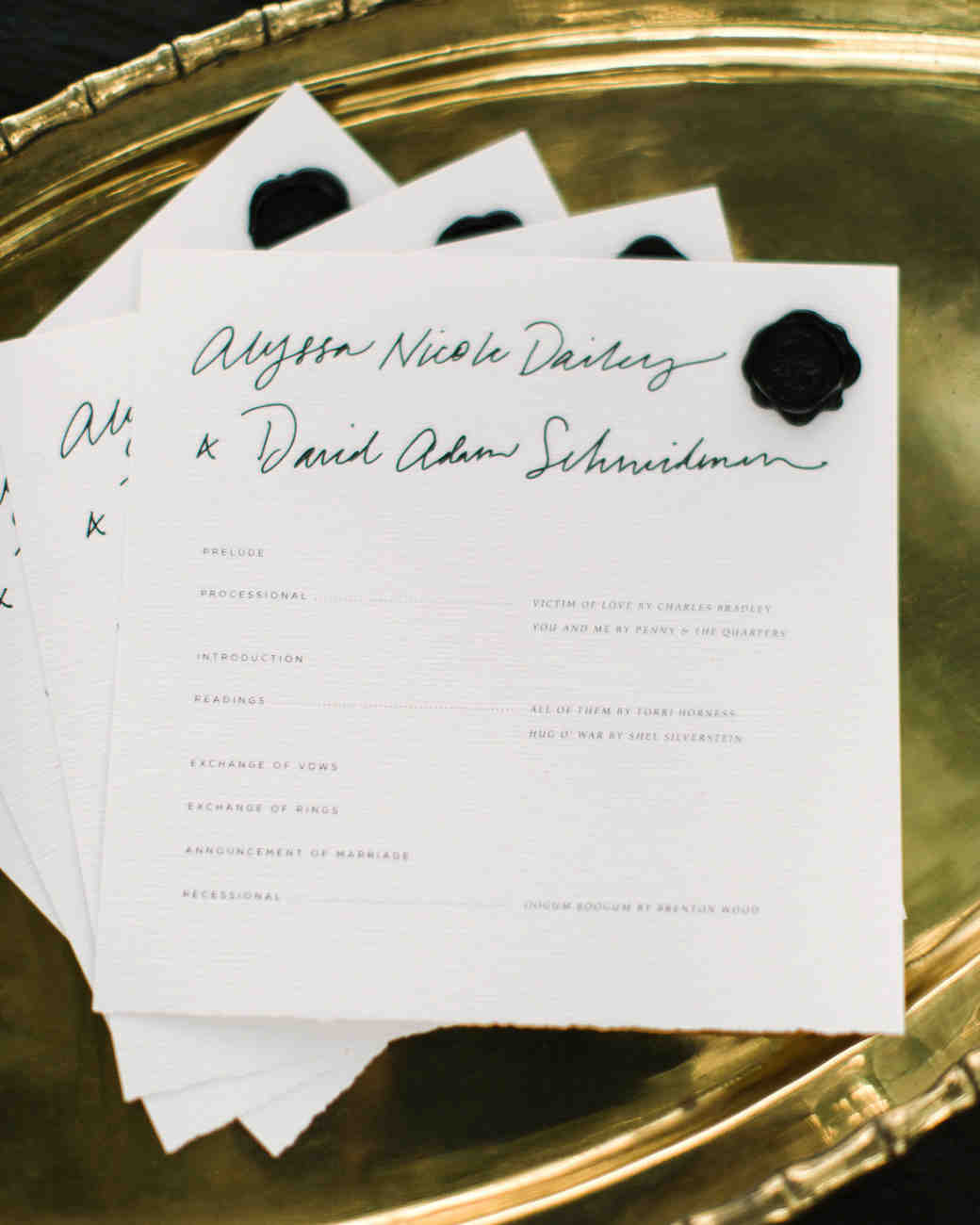 wedding programs on gold tray