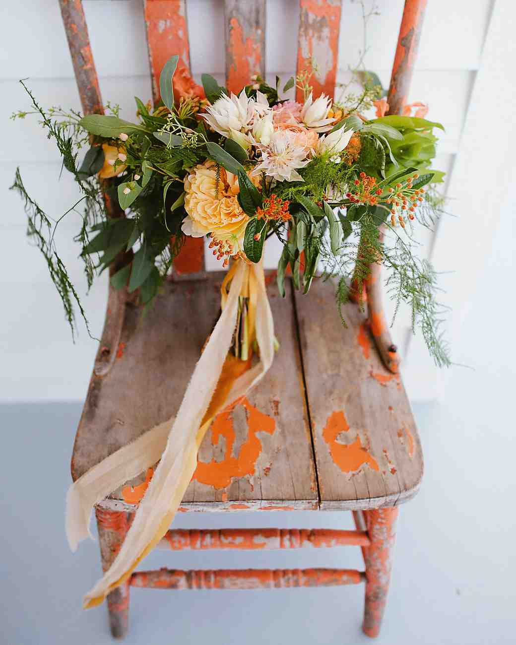 orange protea wedding bouquet