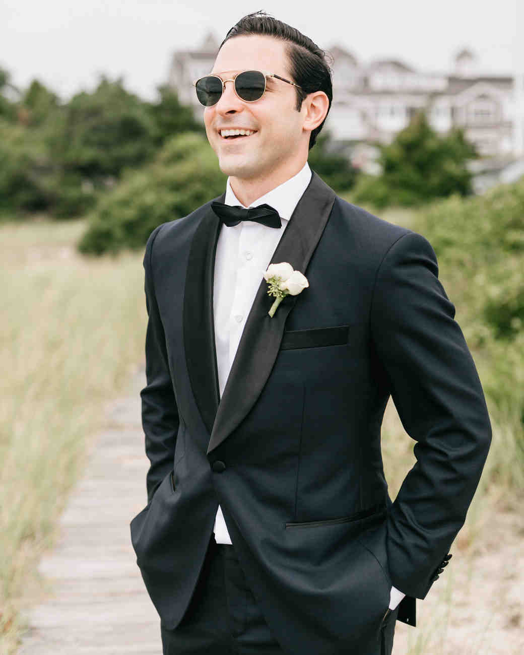 groom wearing sunglasses smiling