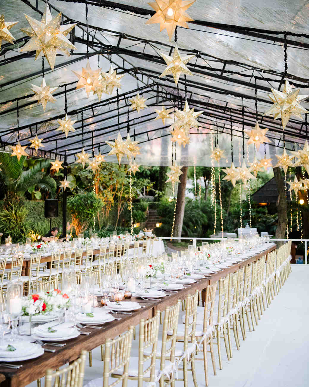 wedding reception tables with star lanterns hanging above