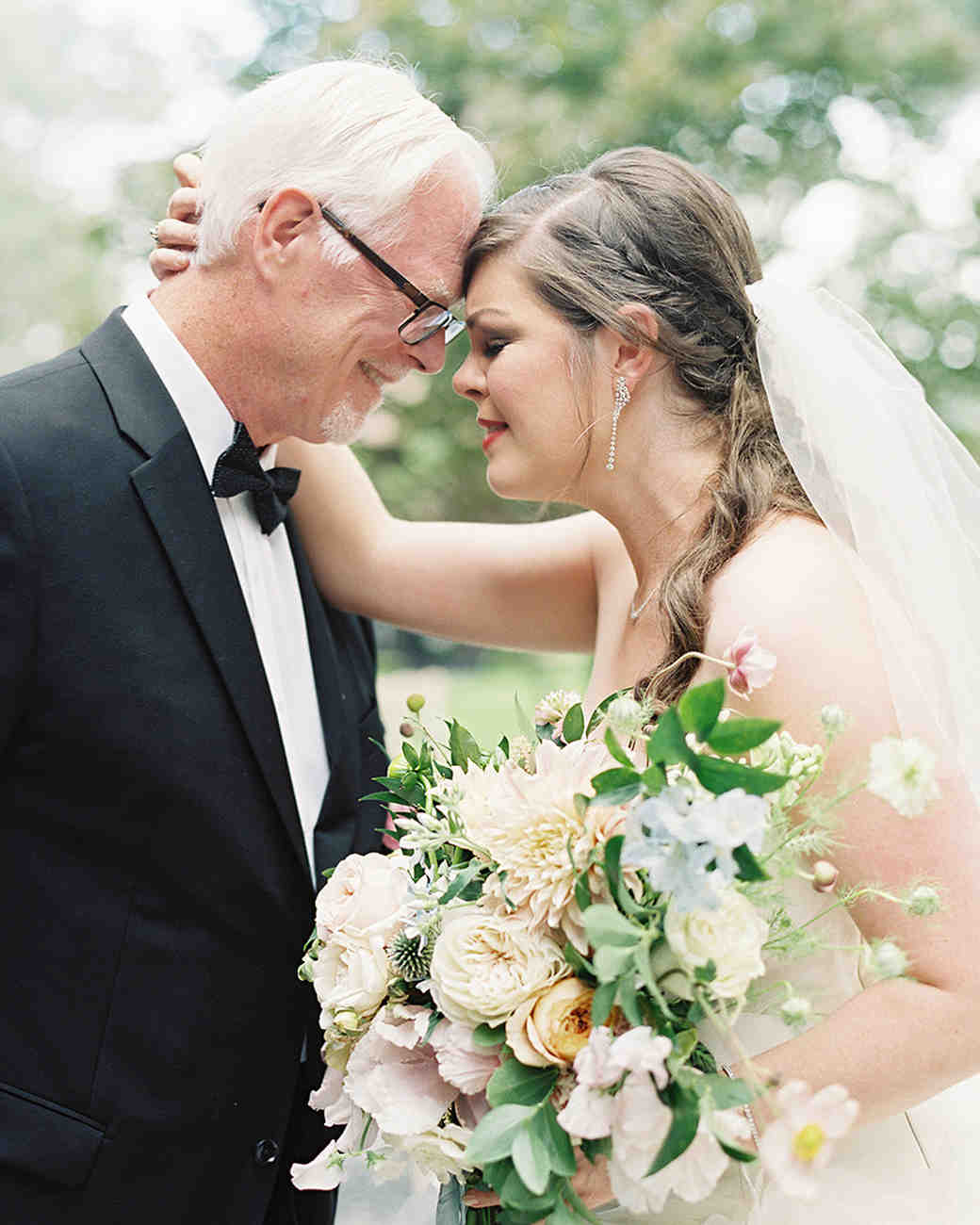 bride and father sharing a moment