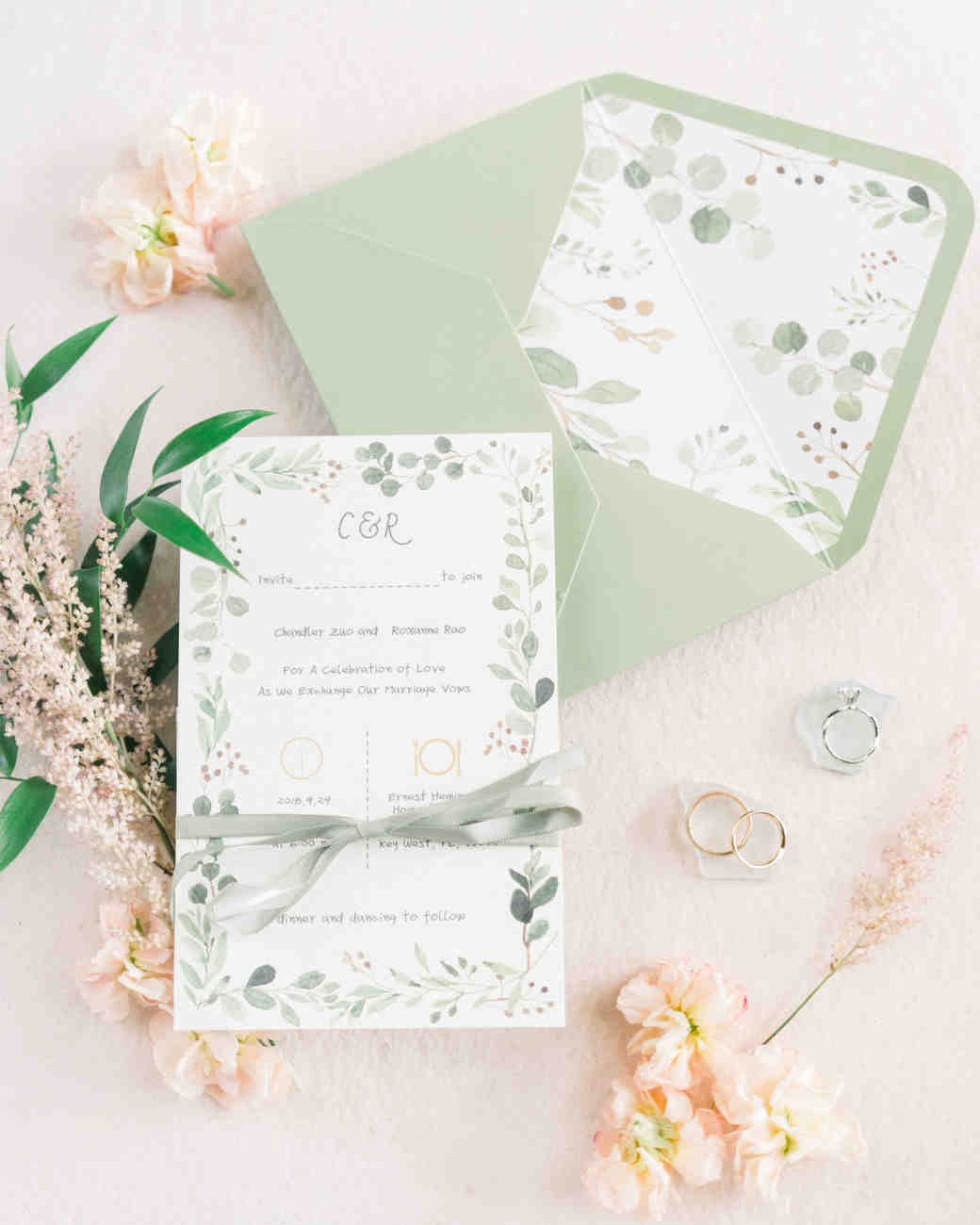 light green invitation suite with greenery