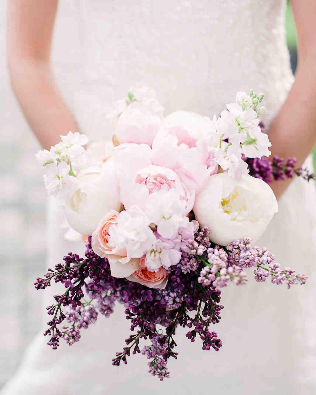 bride holding pink white purple floral bouquet