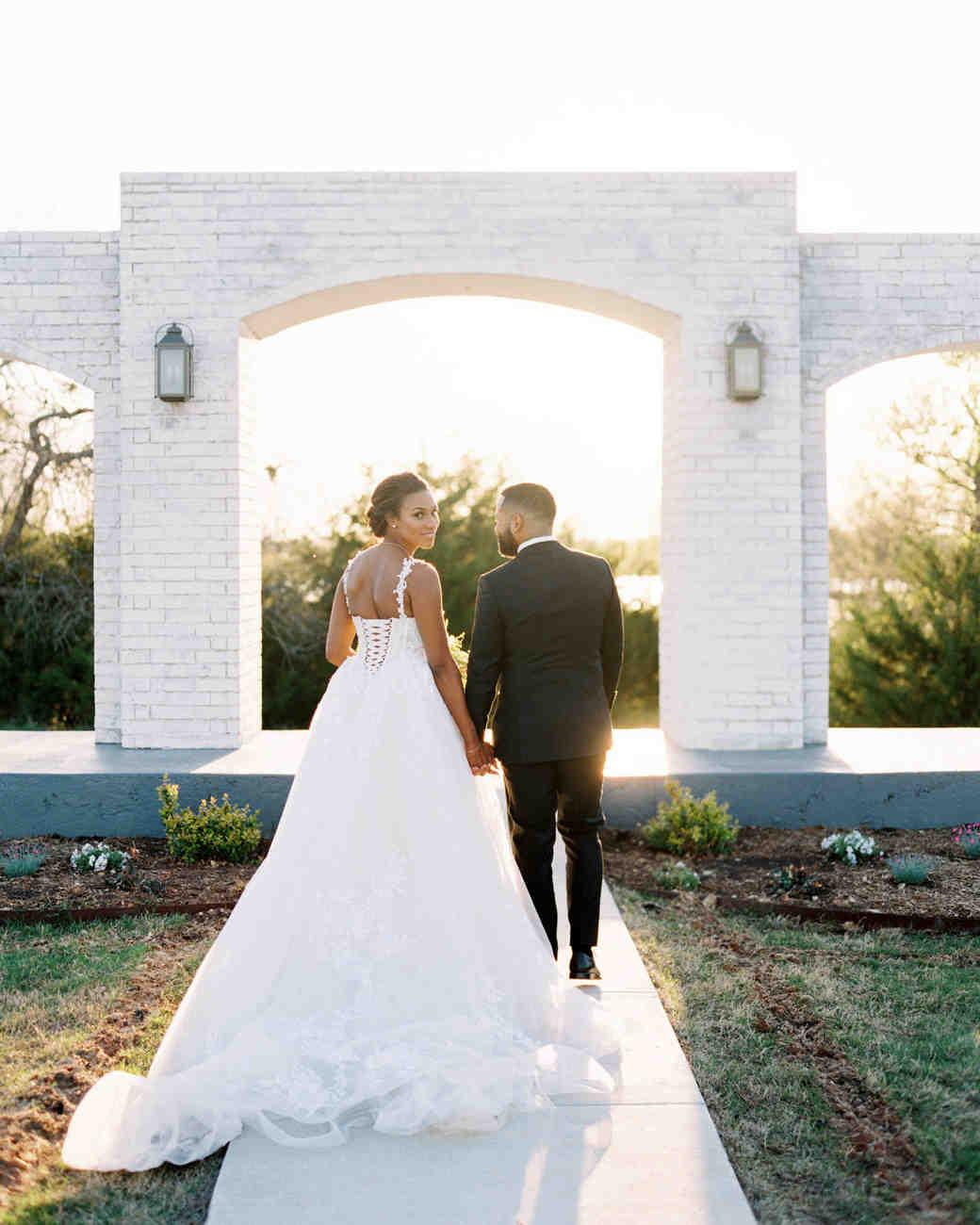 wedding couple walking holding hands