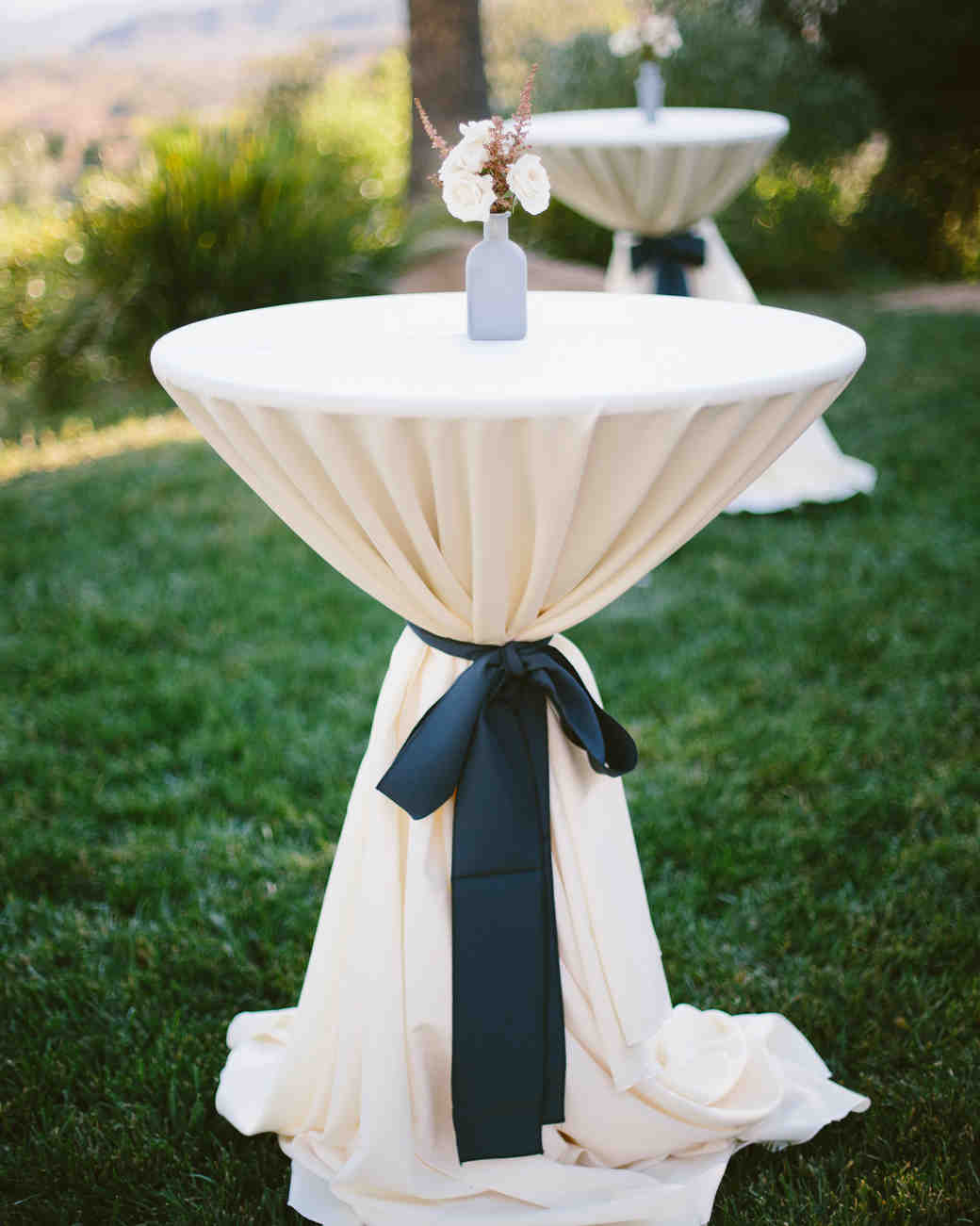 ribbon wedding ideas black ribbon cinching linen on cocktail table