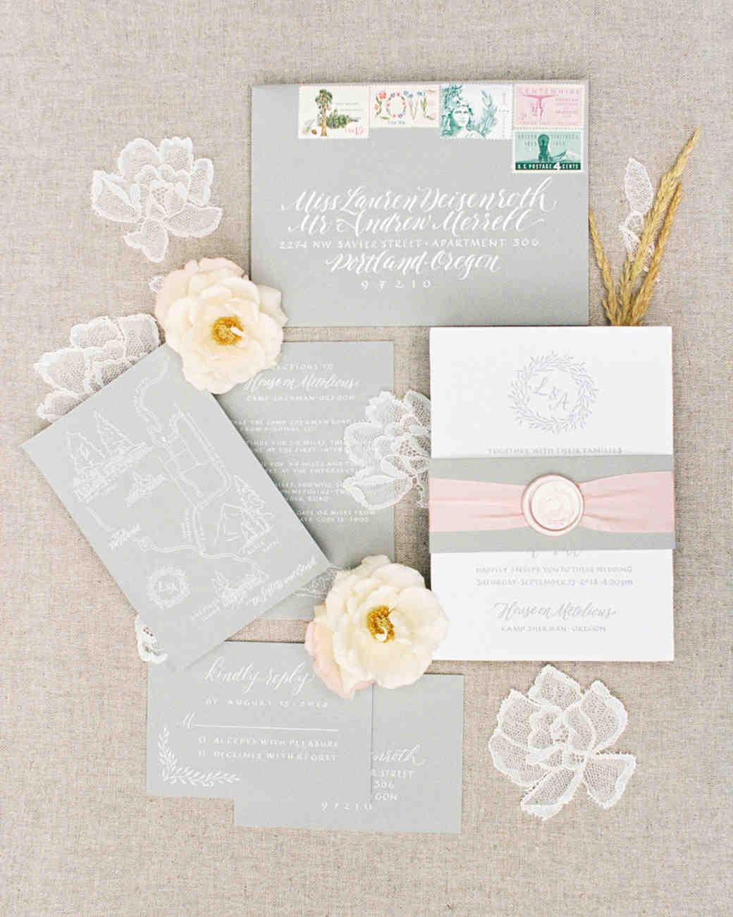 ribbon wedding ideas wax seal and pink ribbon wrapped around invitation