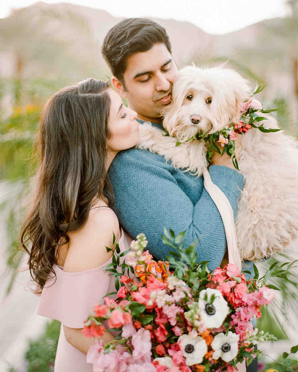 couple with dog and flowers engagement photo