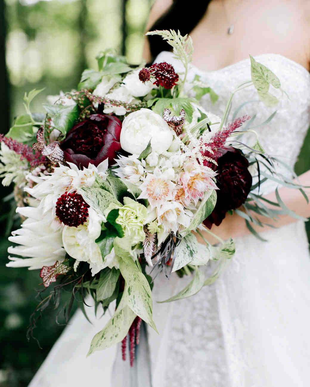white and red protea wedding bouquet