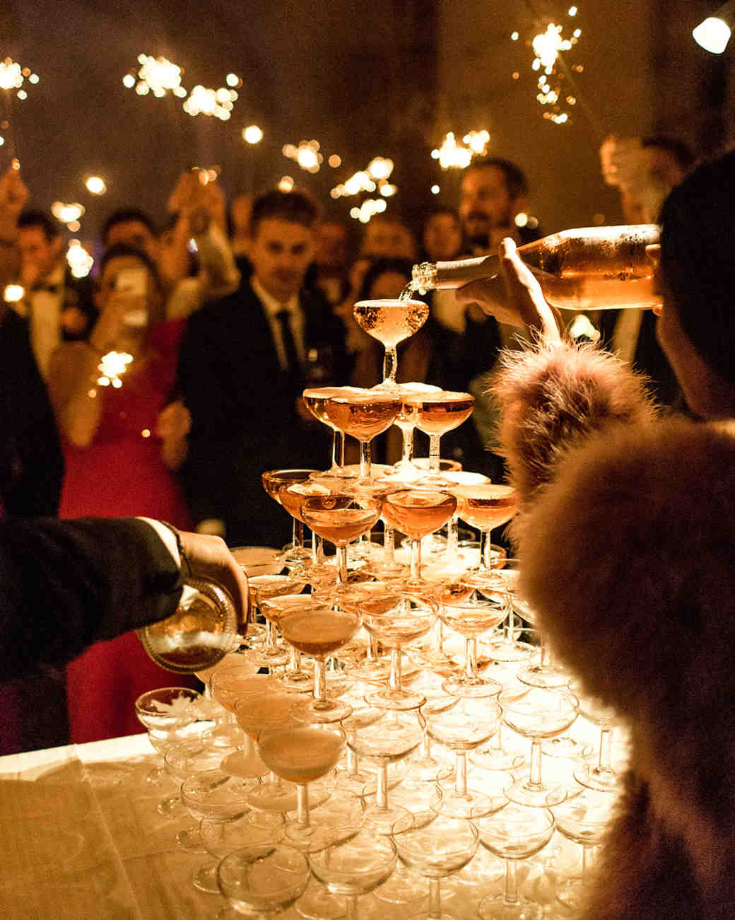 wedding champagne towers guests with sparklers