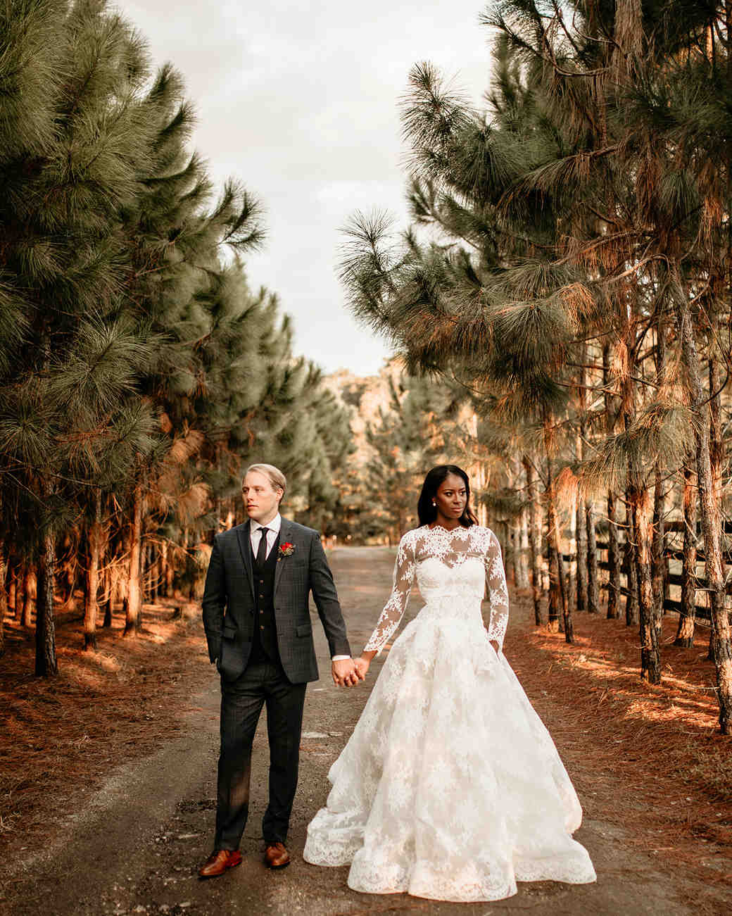 aerielle dyan wedding couple on road with pine trees