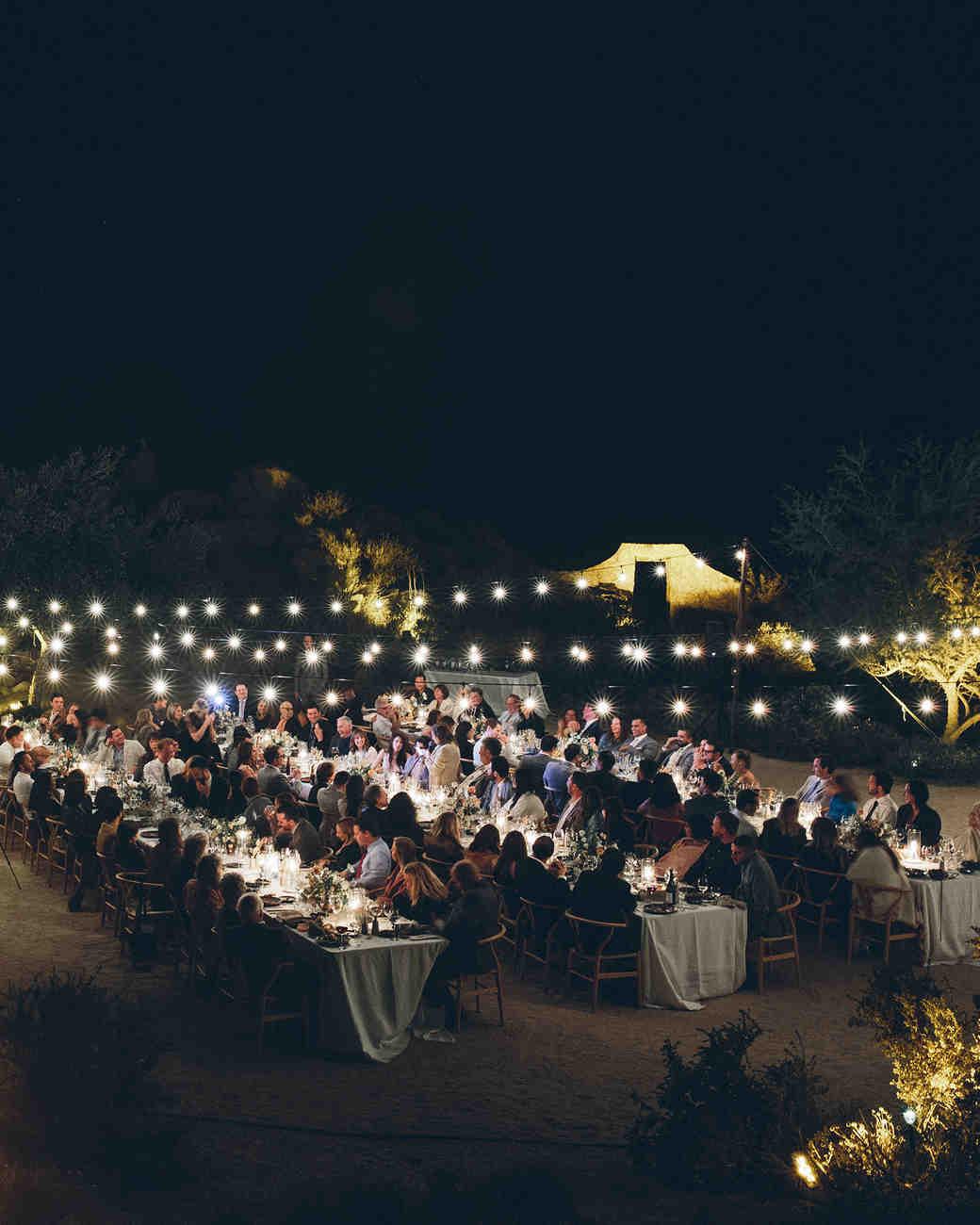 ashley basil wedding dinner string lights at night