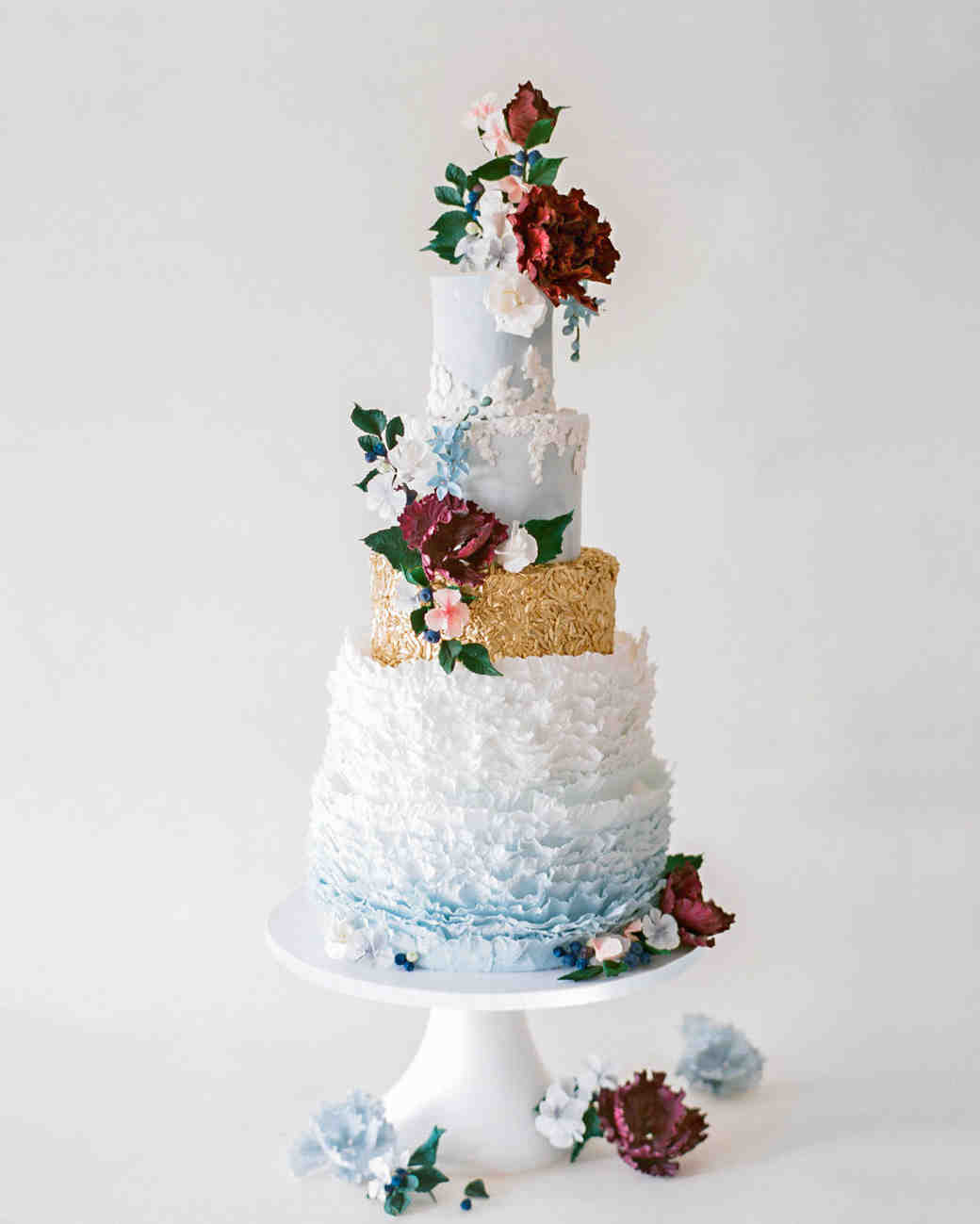 Blue, White and Gold Ruffled Wedding Cake