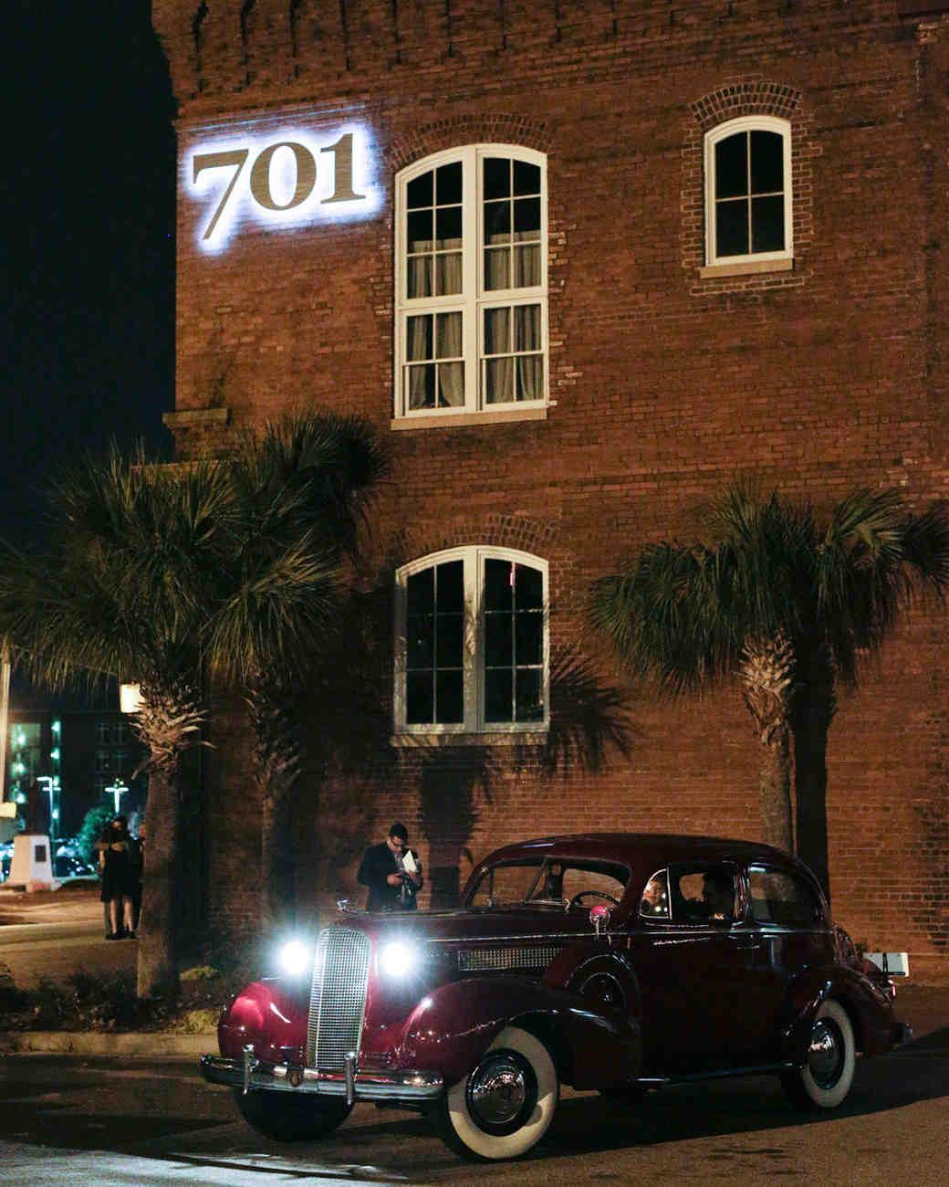 elizabeth seth wedding vintage car with headlights on outside of venue