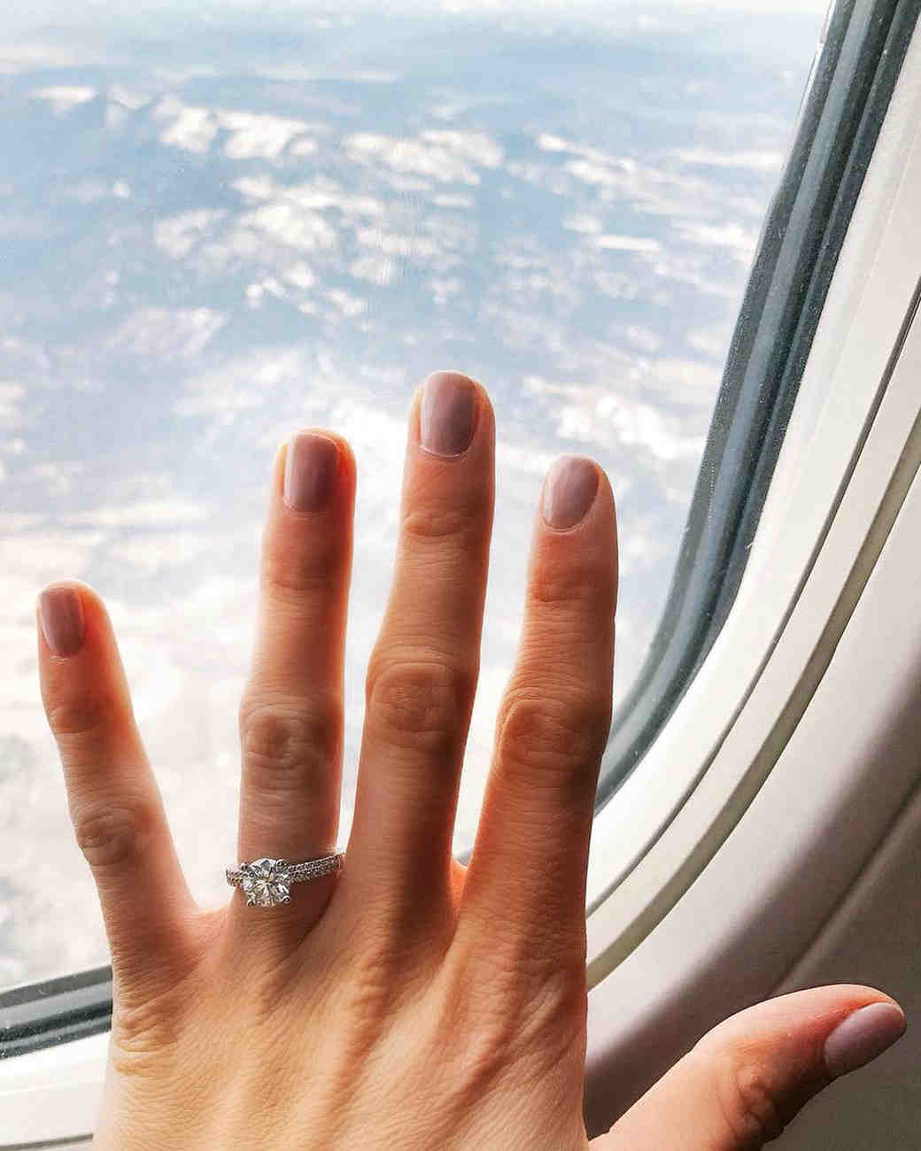 engagement ring selfie airplane window