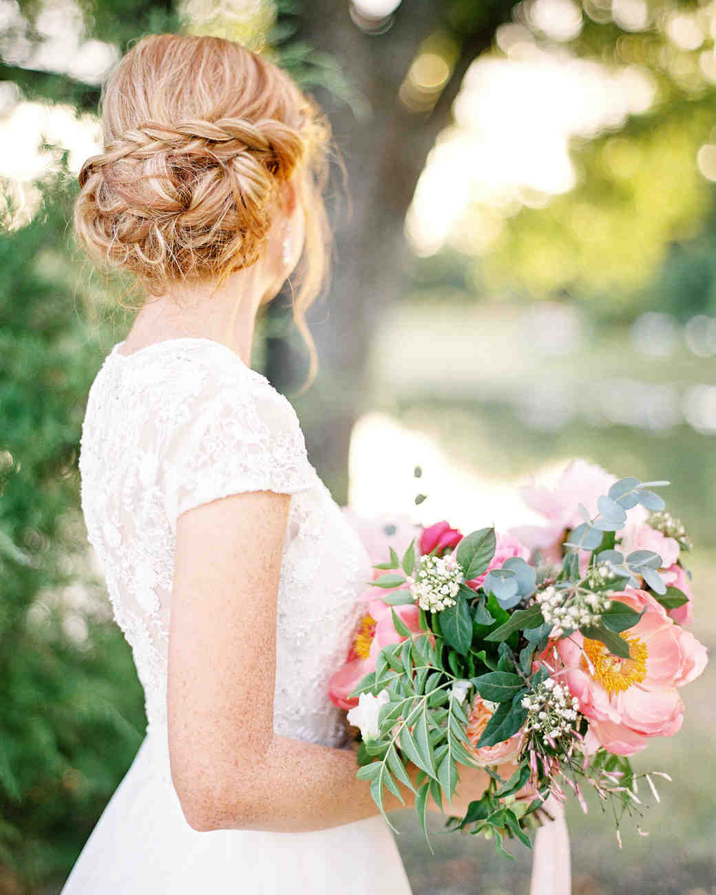 bride with braid-wrapped updo