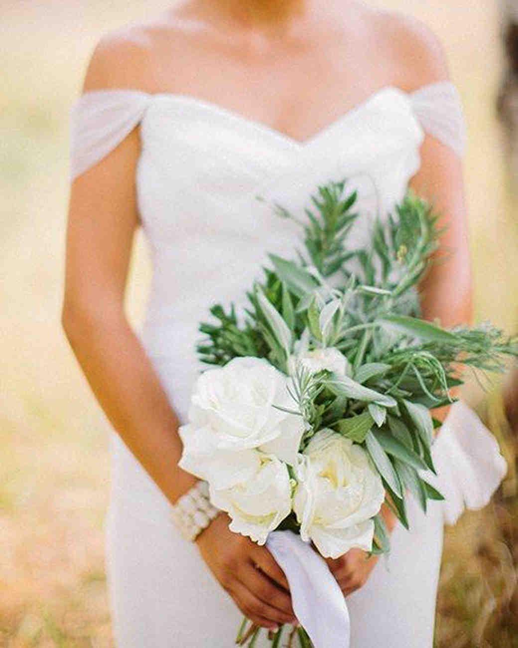 bridge holding sage leafs white floral bouquet