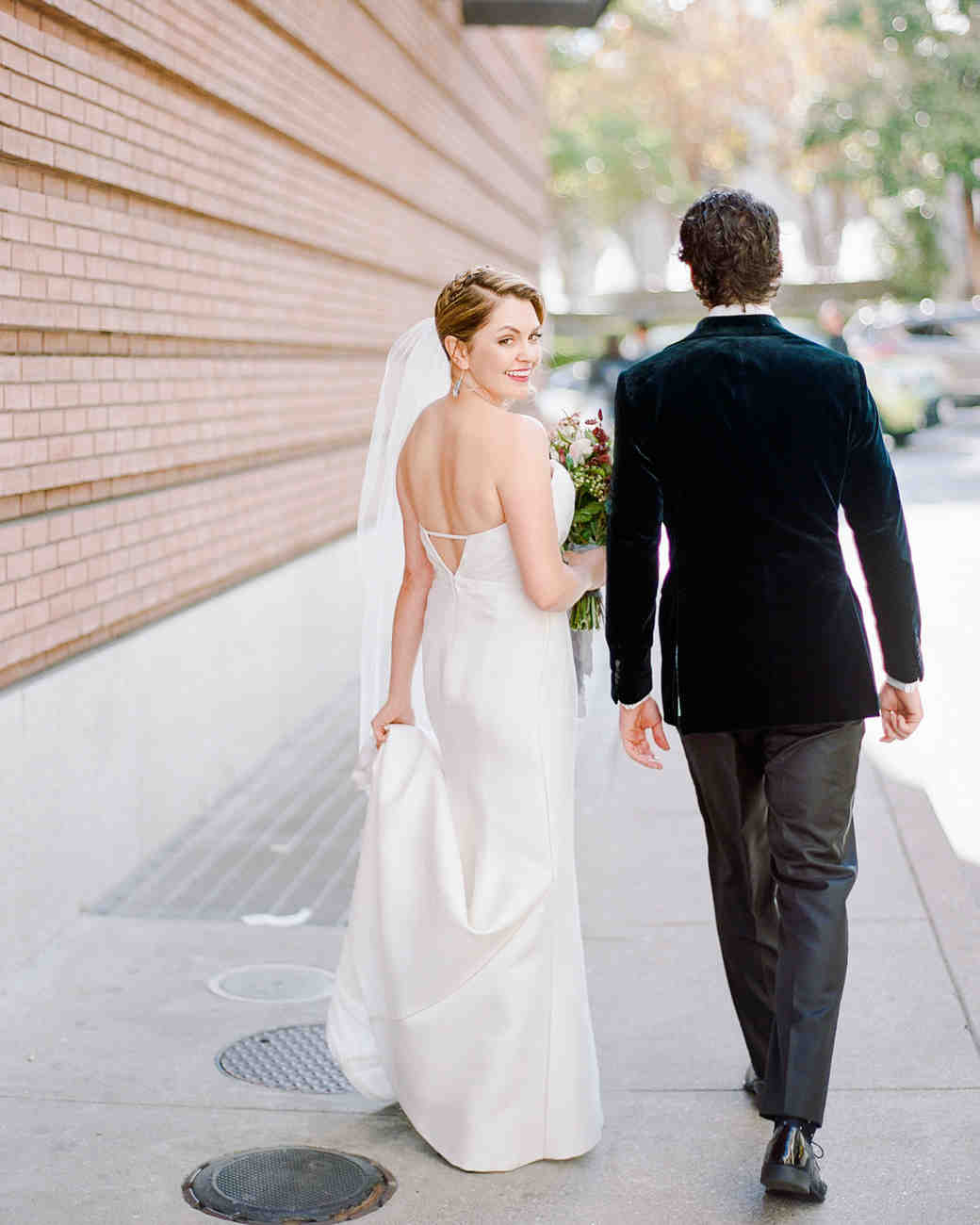 katie andre wedding couple walking bride looking over shoulder