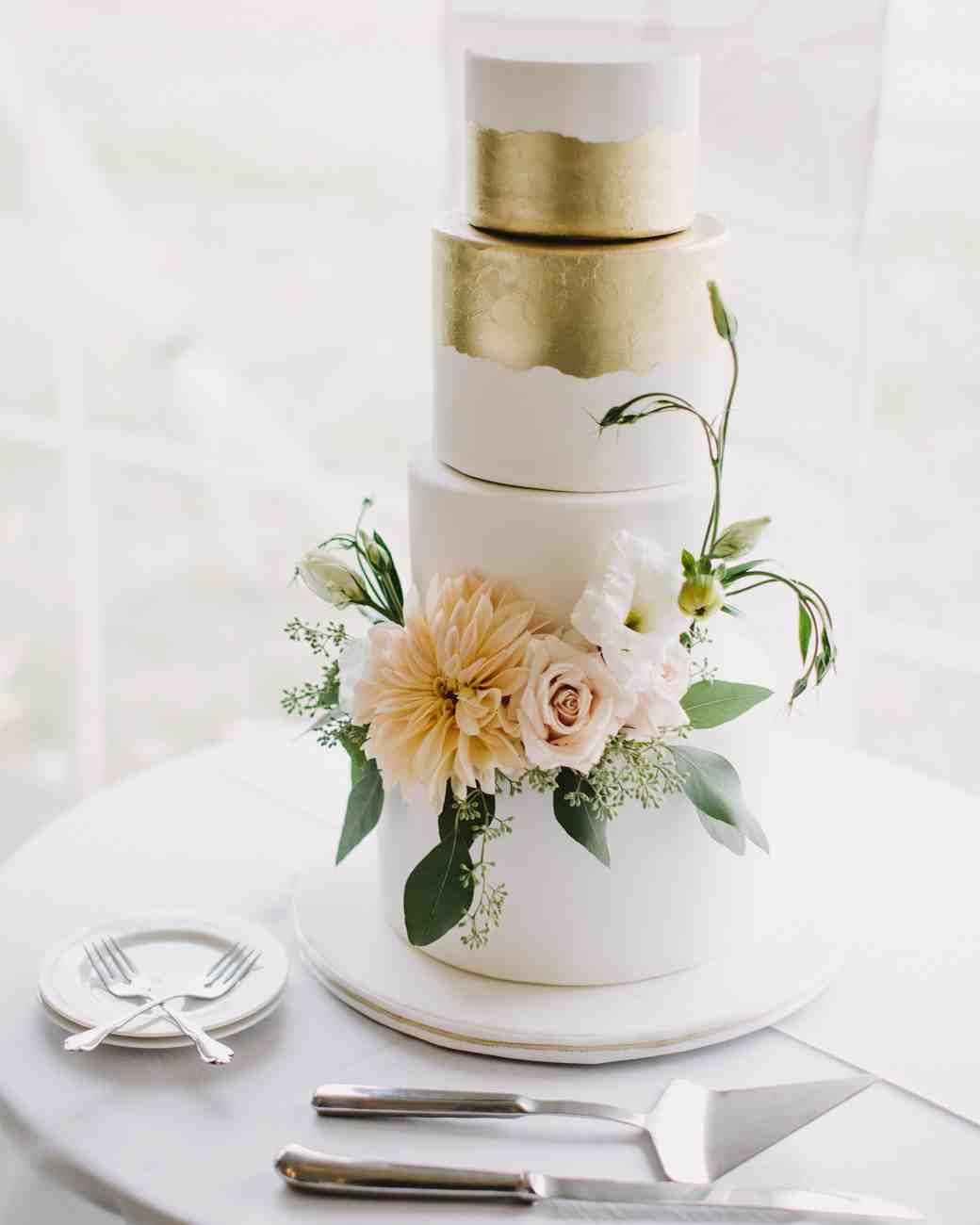 Four Tiered Gold and White Wedding Cake with Floral Cake Toppers