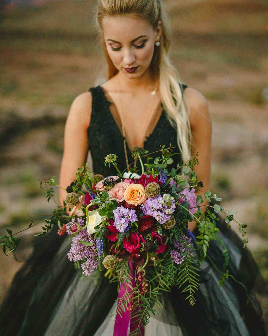 A Bride Holding a Lilac Bouquet