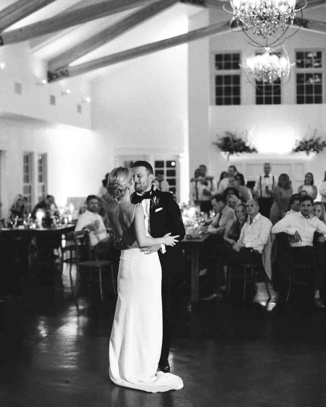 bride and groom share their first dance together