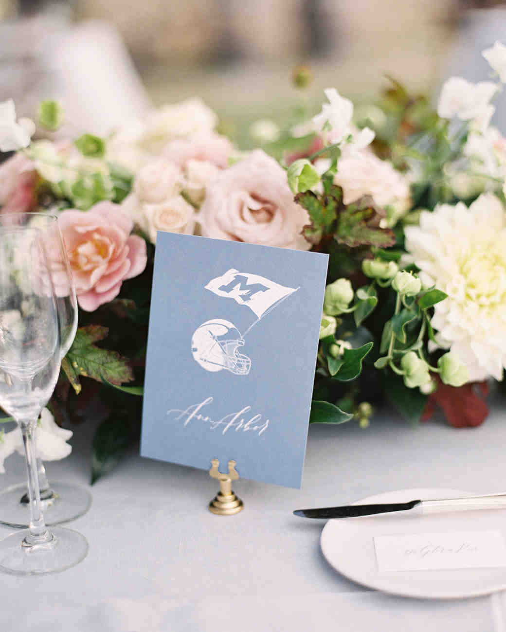 wedding decor sports themed place card blue flowers table