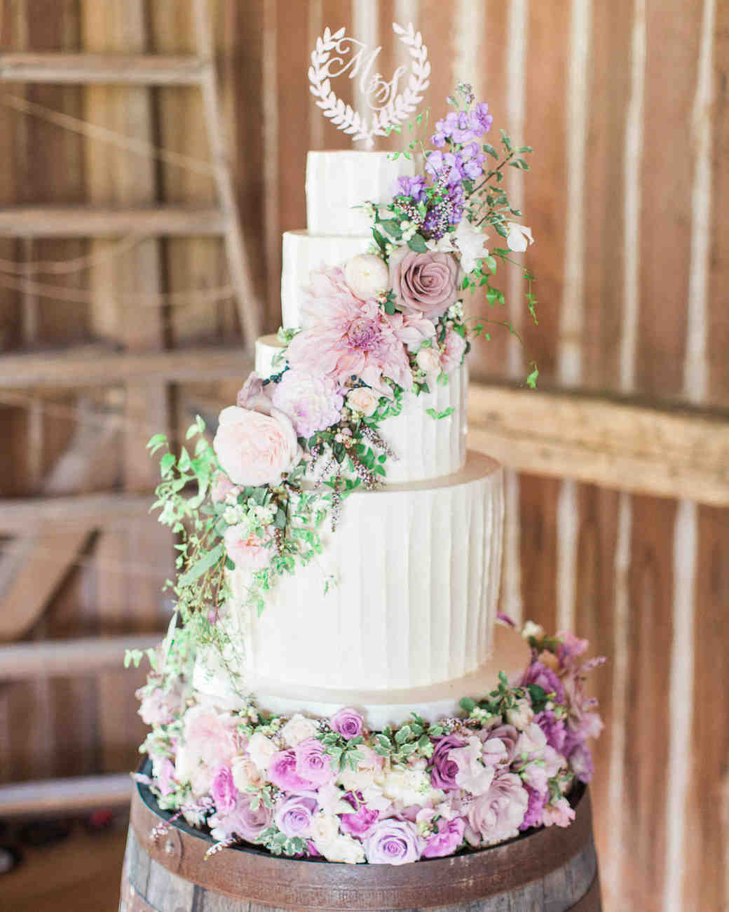 White Wedding Cake with Pink and Purple Flowers