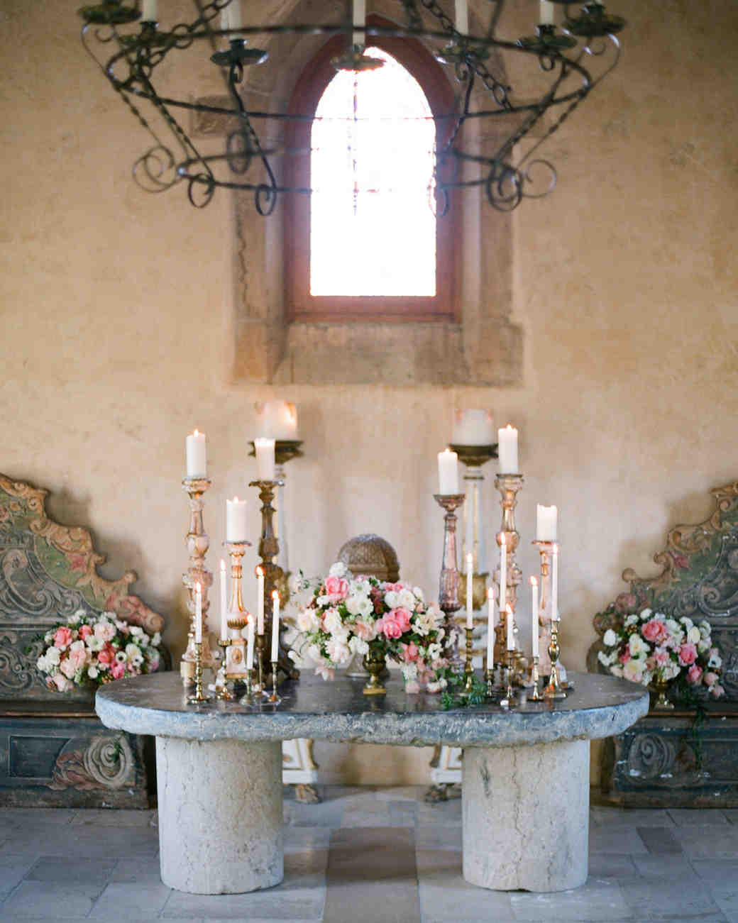 stone table decorated with roses and candles