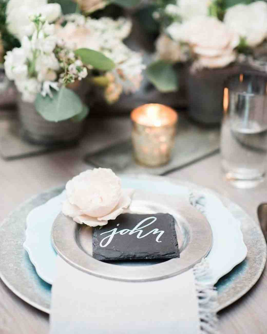 a rose and slate place card on silver plate