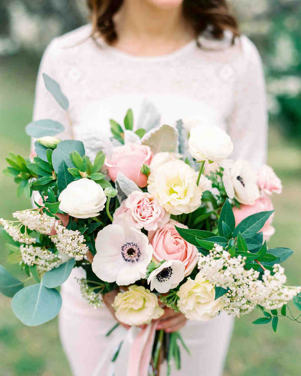 Bride Holding a Pink and Ivory Bouquet