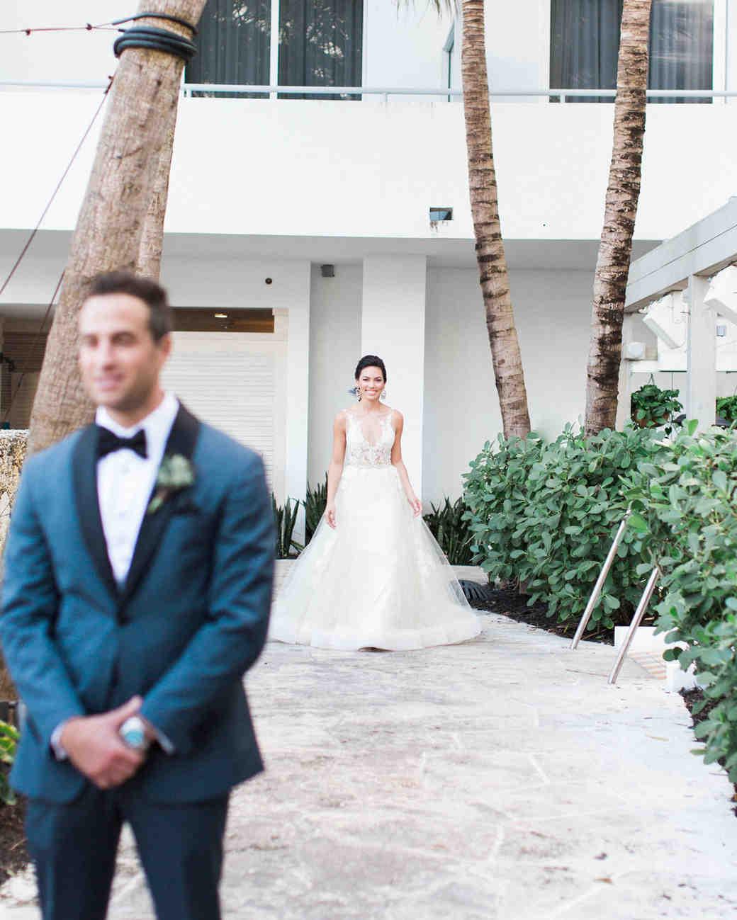 groom prepares for firstlook of bride
