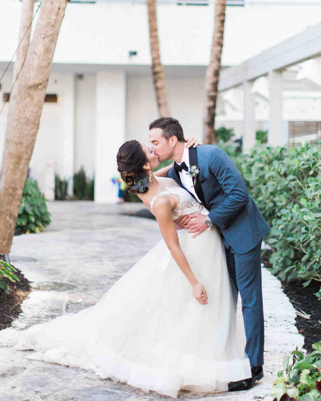 bride and groom kiss after firstlook