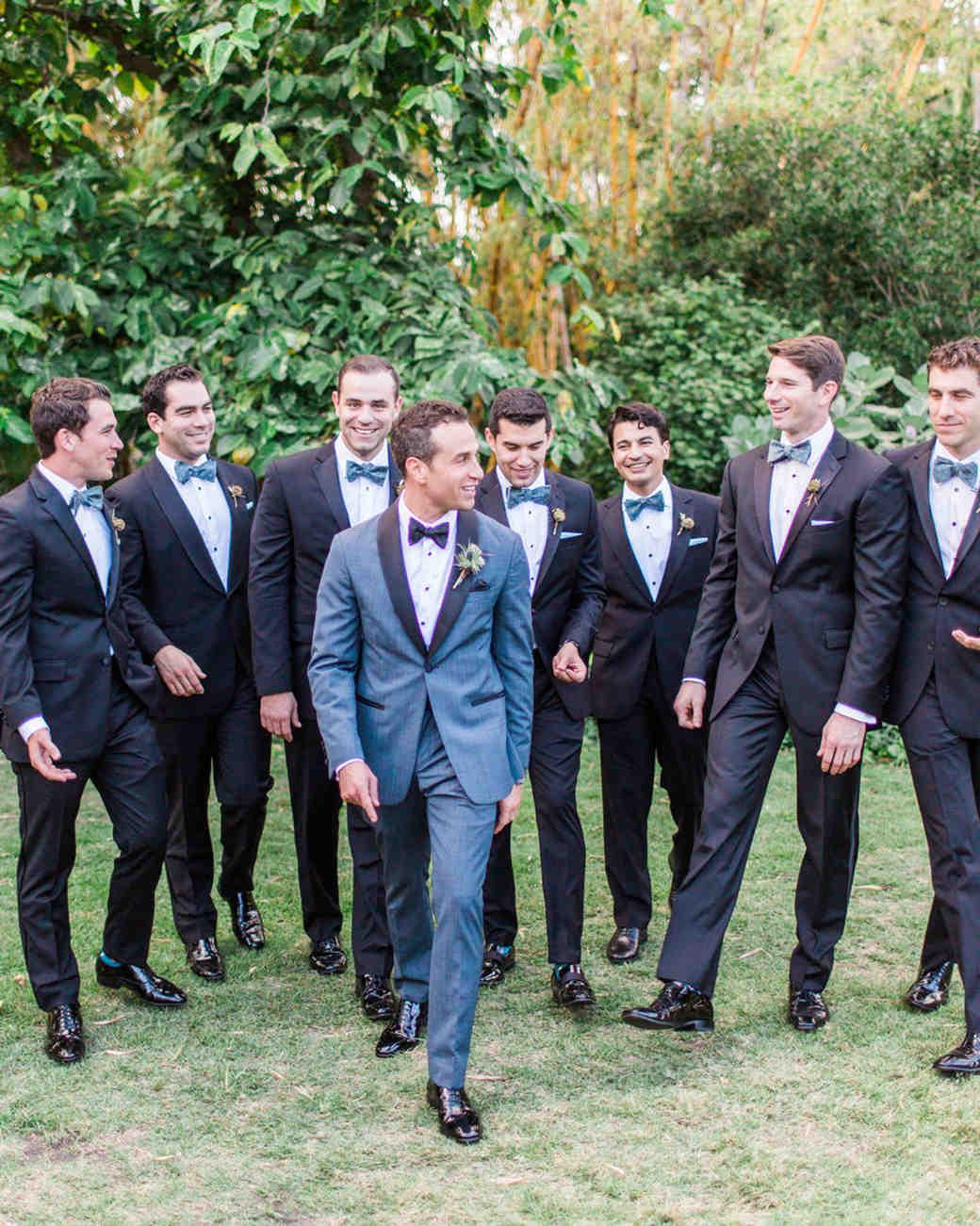 groom poses with groomsmen smiling