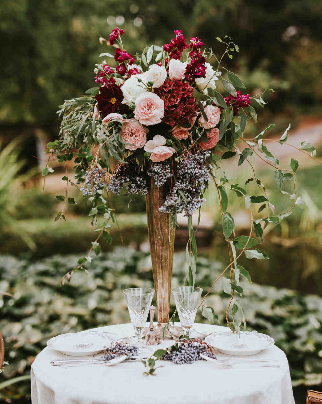 tall centerpiece with hydrangeas roses and ranunculus