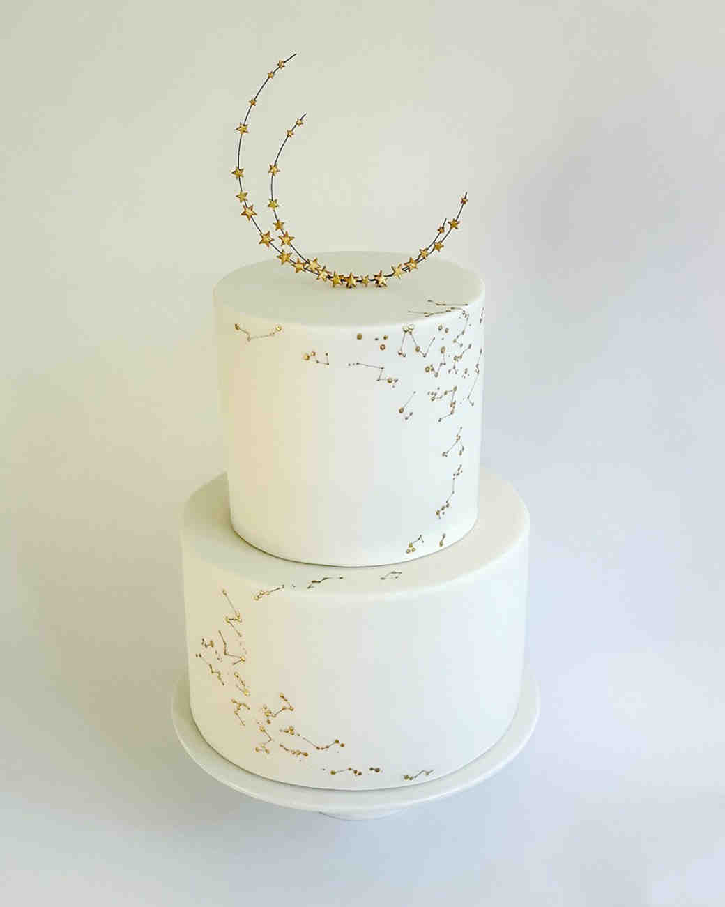 white wedding cake with moon and stars