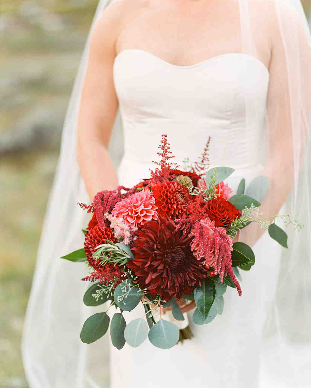 bride holding red bouquet
