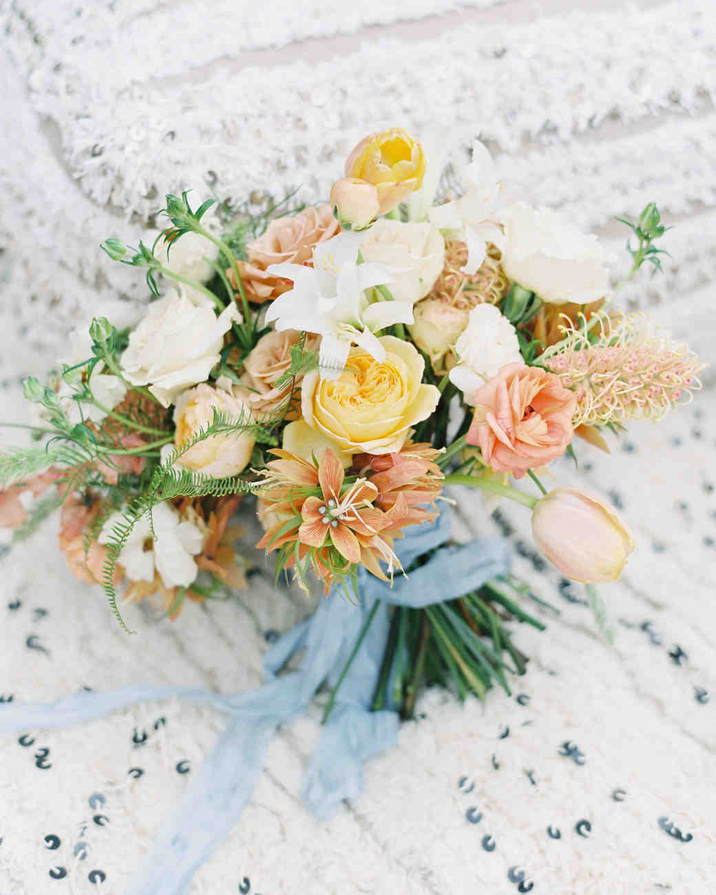 yellow, blush, and white blooms with greenery bouquet